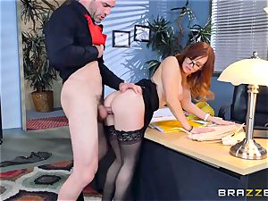 Dani Jensen frolicking with sausage in the office