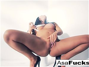 Asa Akira uses a faux mitt to sate her vag
