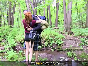 puny redhead humped in the forest
