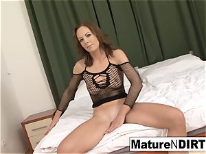 brown-haired milf jacks before taking a big black cock