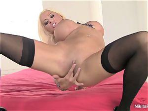 Russian milf Nikita fingers her tight honeypot
